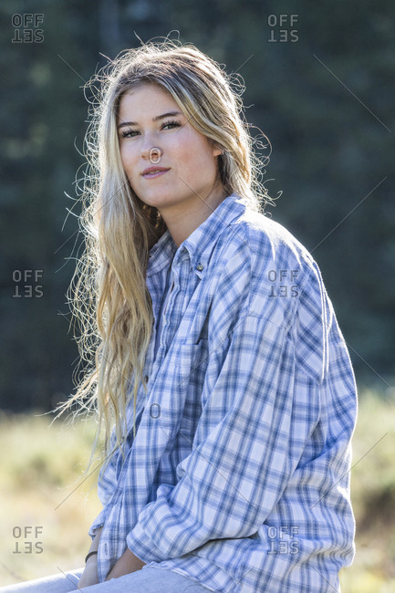 Portrait of smiling Caucasian girl wearing plaid shirt