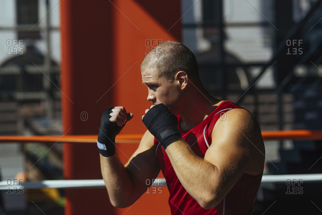 Portrait of Caucasian boxer with fists raised