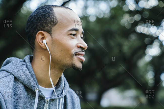 Black man listening to ear buds