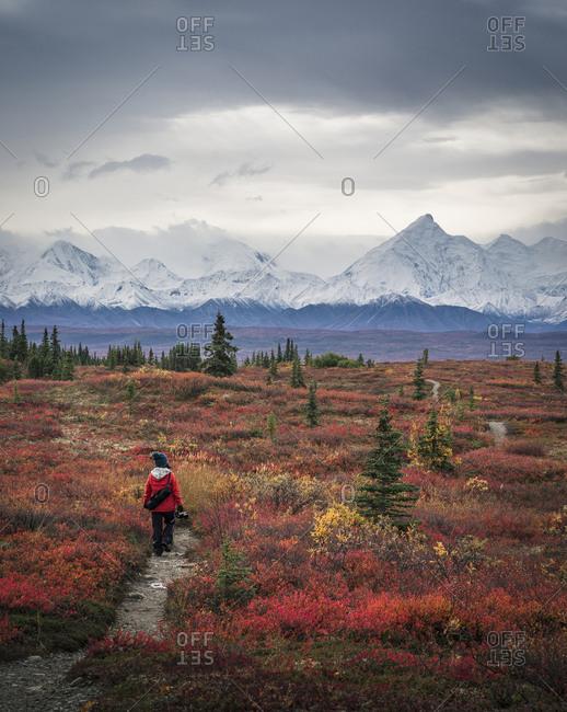 Asian woman hiking near mountains