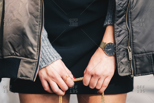 Close-up of a woman wearing a watch and a jacket