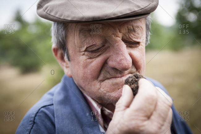 Lalbenque, France: July 28, 2012: Michel Astruc smells a freshly unearthed truffle