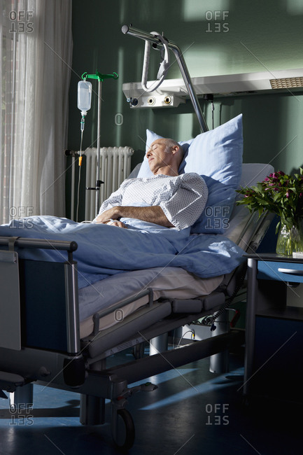 A man sleeping in a hospital bed