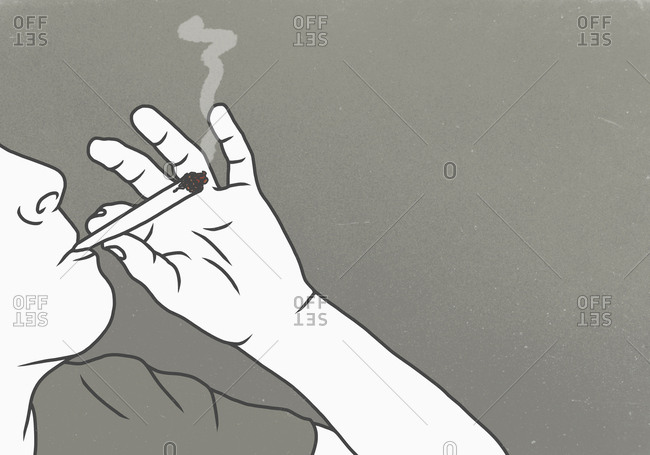 Cropped image of man smoking marijuana against gray background