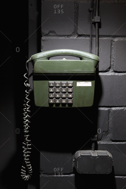 A old-fashioned telephone on a wall