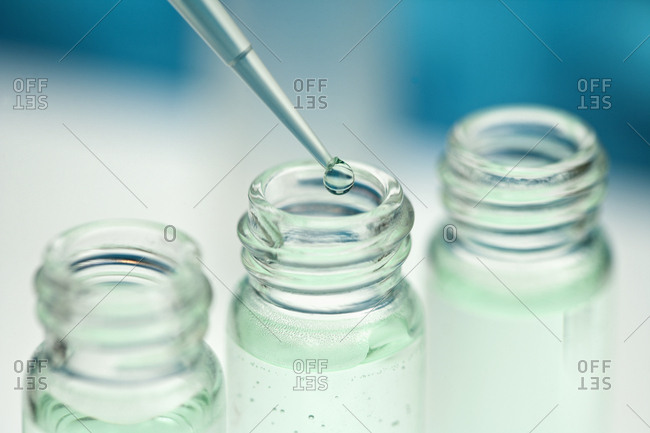 Pipette over 3 glass jars