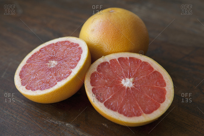 Close-up of pink grapefruits on table