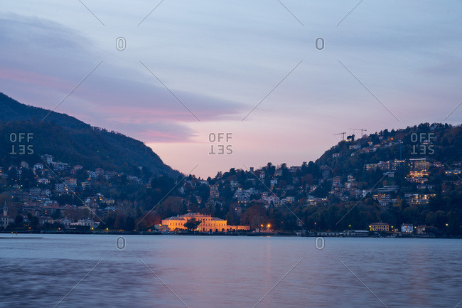 City illuminated at dusk in the Lake Como area, Italy