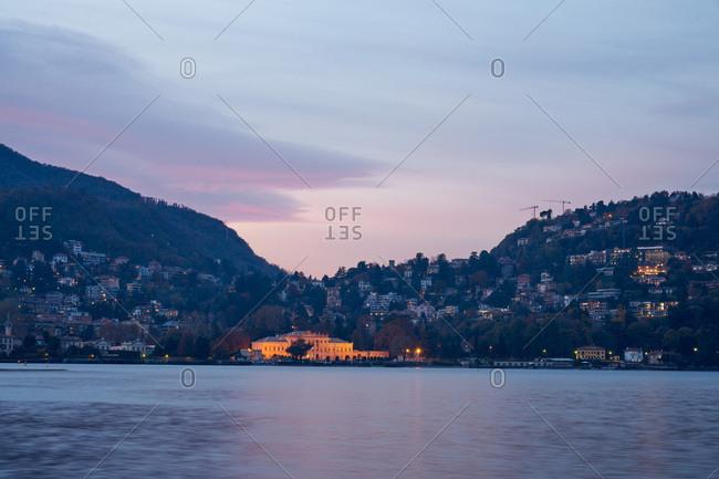 City illuminated at dusk in the Lake Como area, Italy