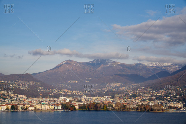 Snow-capped alps behind the city of Lugano, Switzerland