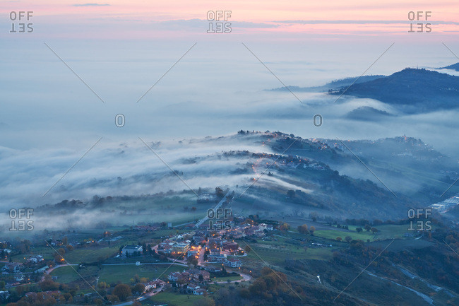 Elevated view of San Marino, Europe at sunset