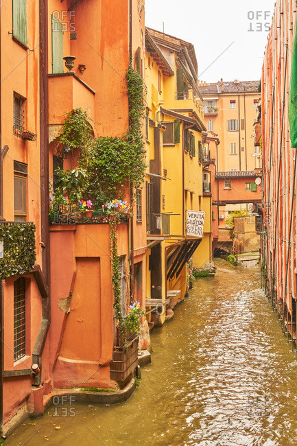 Bologna, Italy - November 26, 2017: River running between colorful buildings in Bologna, Italy
