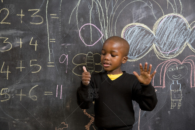 School girl child counting on his hands