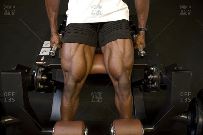 Legs of an African man working out