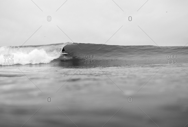 Water shot of surfer getting barreled