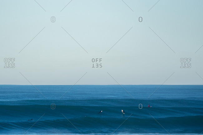 Surfers waiting for next wave during big swell