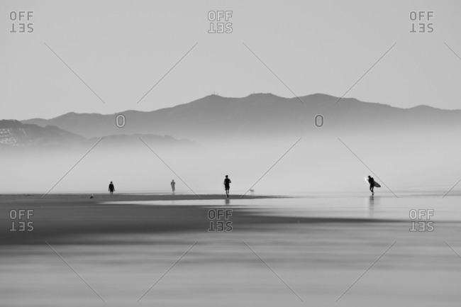 People doing morning activities on tranquil beach