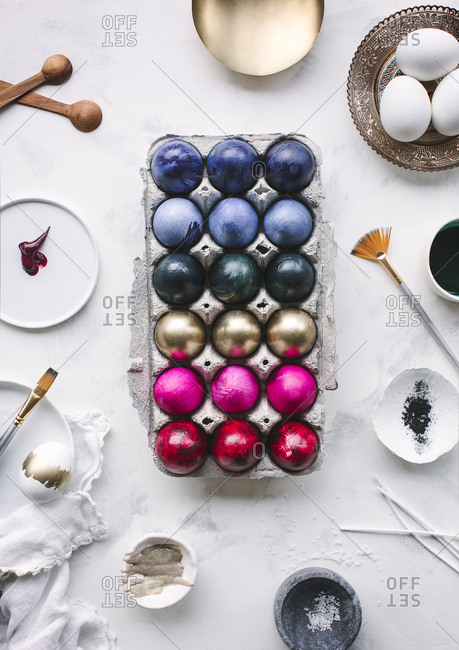 Multicolored Easter eggs and painting supplies