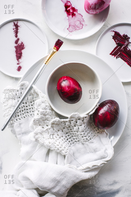 Red Easter eggs and paint supplies