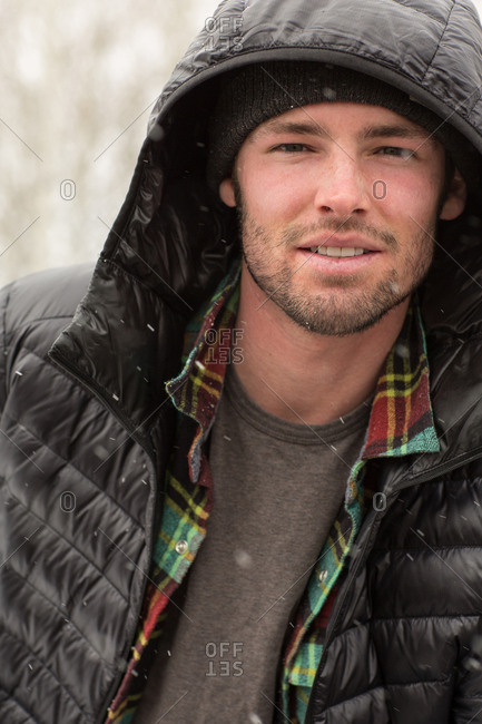 Portrait of a man outdoors wearing black jacket in winter