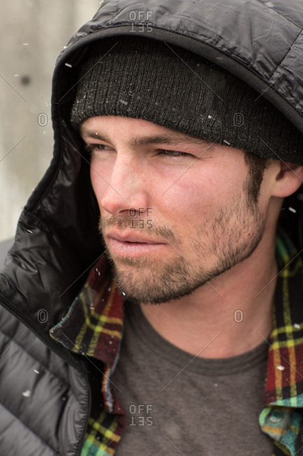 Portrait of a man outdoors as snow falls