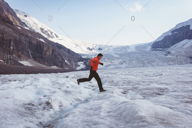 Man walking on a snow landscape during winter