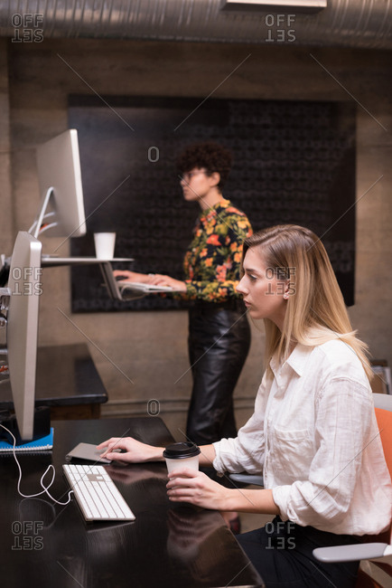 Female executives working on computer in office