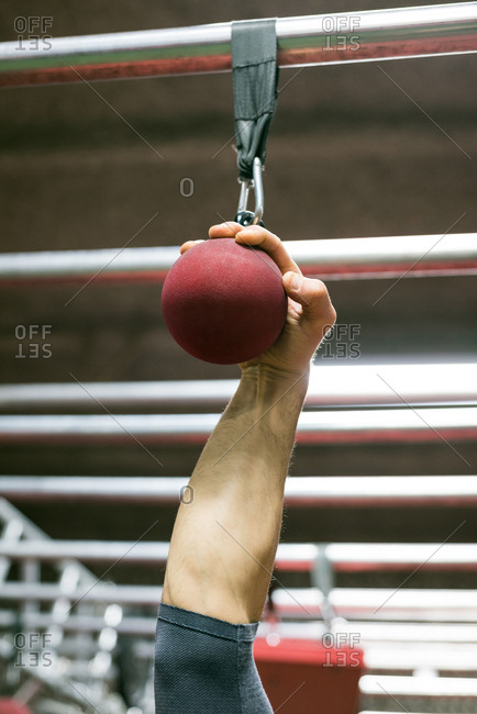 Close-up of muscular man holding a ball grip for pull up