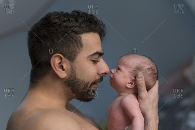 Father holding baby daughter