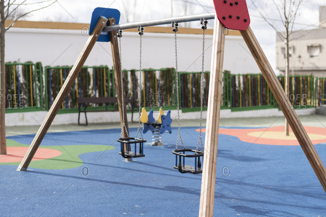 Empty swing set in public preschool playground