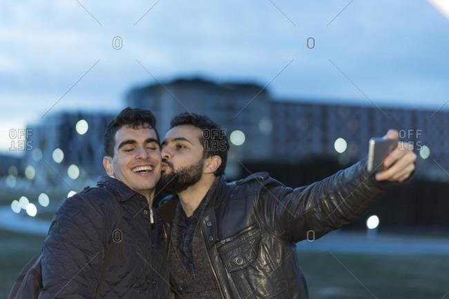Male couple taking a selfie