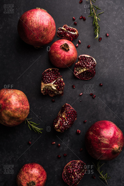 Still life with pomegranates and rosemary