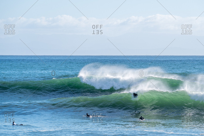 Surfers ride waves during big swell