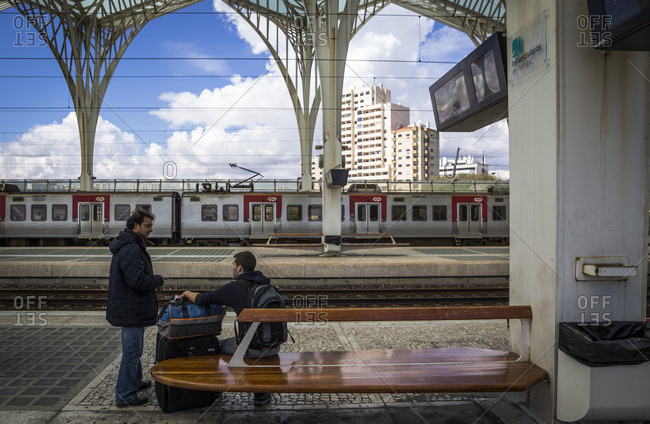 Lisbon, Portugal - March 21, 2016: People waiting on the platform of the Oriente train station
