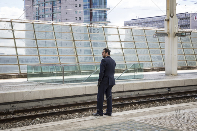 Lisbon, Portugal - March 21, 2016: A man waits on the platform of the Oriente train station