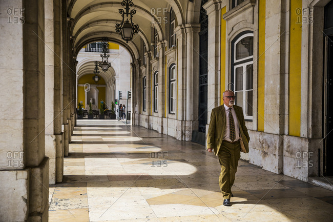 Lisbon, Portugal - March 28, 2016: A man walks outside the Ministry of Justice