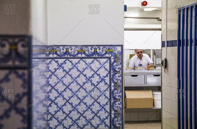 Lisbon, Portugal - April 3, 2016: View of the kitchen at Pasteis de Belem