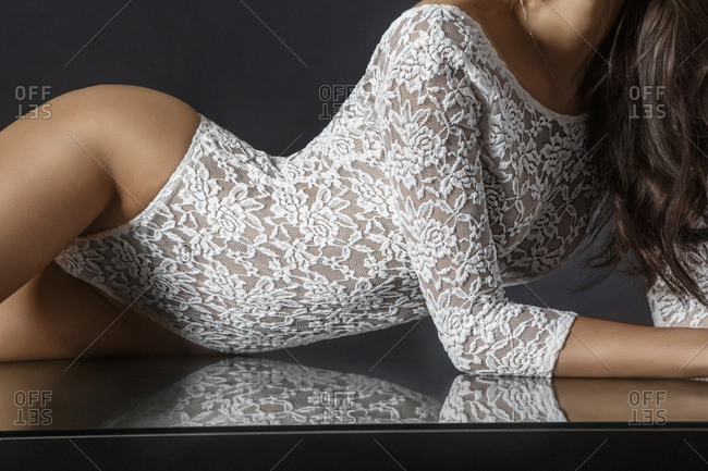Woman wearing white lace bodysuit