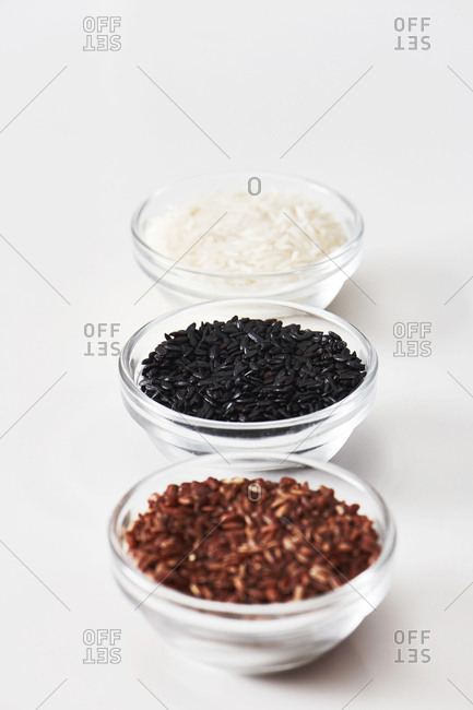 Different types of heirloom rice including jasmine, black and red rice