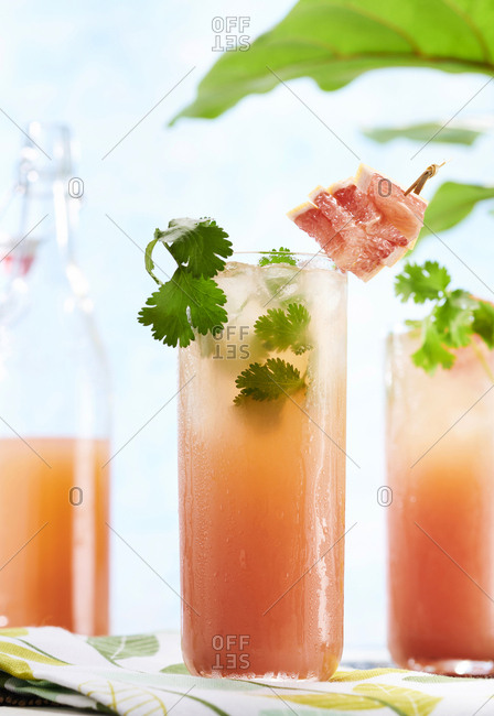 Grapefruit cocktails with cilantro in colorful setting
