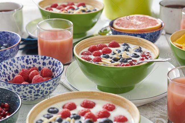Healthy breakfast with yogurt, fruit, grapefruit juice and herbal tea