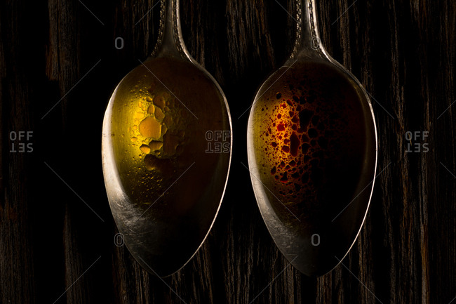 Spice infused olive oil in antique spoons
