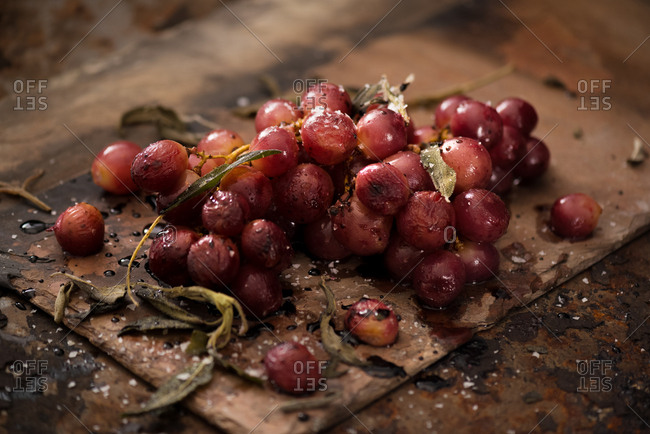 Roasted grapes with sage in rustic subdued light setting