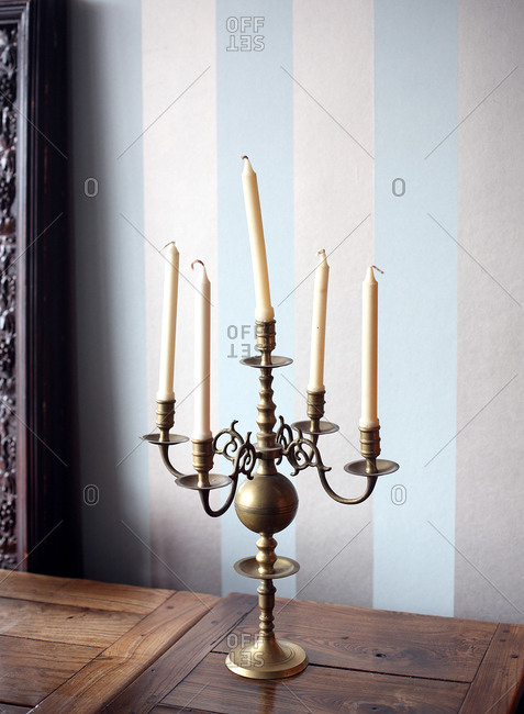 Brass candelabra on a wooden table