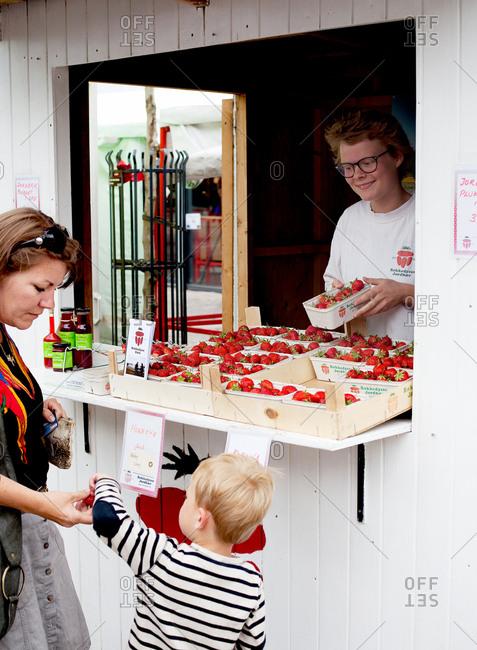 Copenhagen, Denmark - May 2, 2008: Strawberry vendor at a market