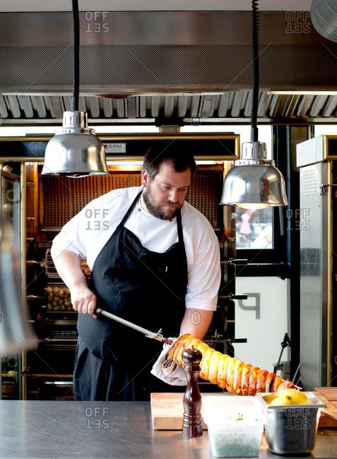Copenhagen, Denmark - May 2, 2008: Chef in a restaurant cooking meat