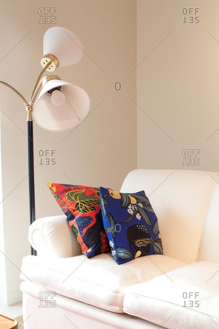 Colorful pillows on a white sofa