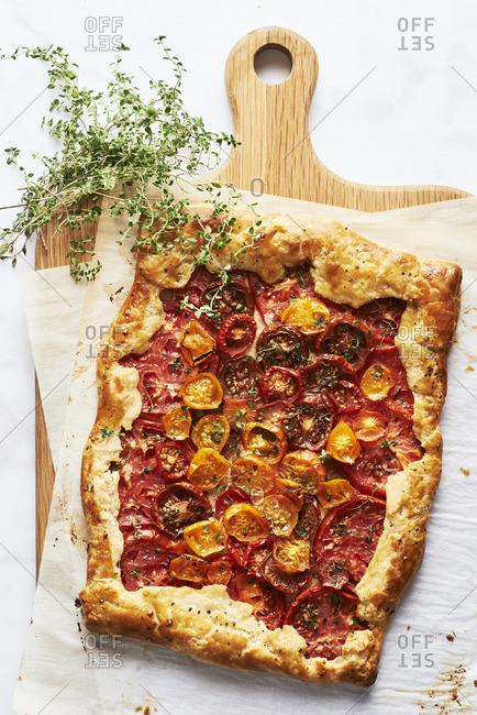 Overhead view of Rustic Cherry Tomato Tart Provencal with lemon thyme garnish