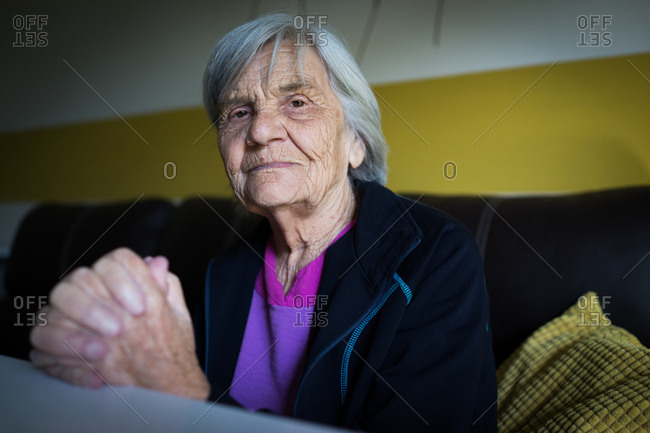 Senior woman sitting in the room
