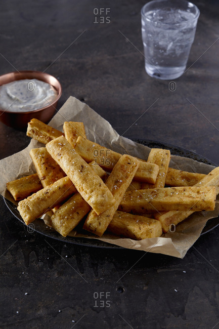 Polenta fries on serving dish with dipping sauce